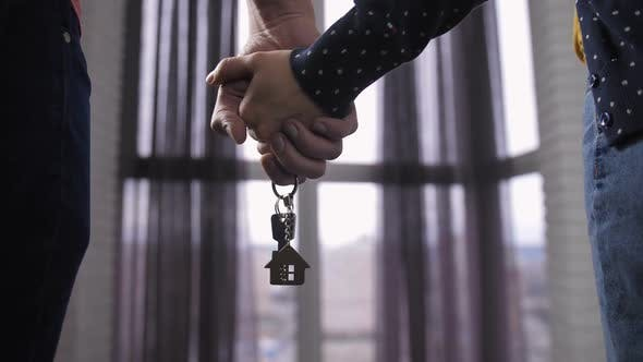 Thumbnail for Couple Holding Hands with New Home Keys