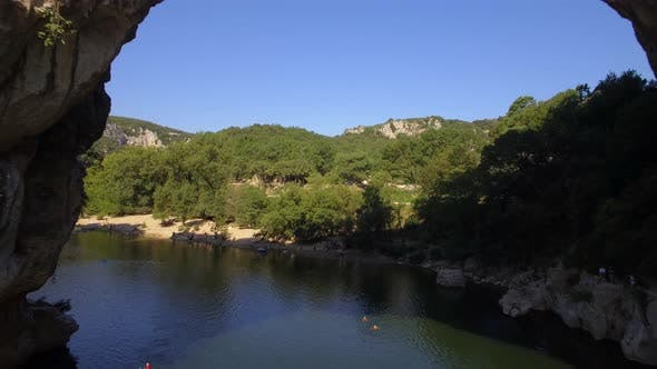 Thumbnail for Aerial travel drone view of the Pont d Arc natural arch and river, Southern France.