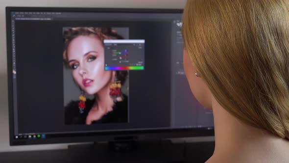 Thumbnail for A Blonde Woman Sits at a Computer and Edits a Photo - Closeup