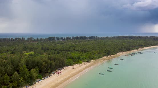Thumbnail for Drone Hyperlapse of a Storm passing next to a tropical beach