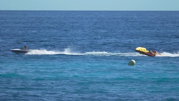 Thumbnail for Tourists Riding Banana Boat, Enjoying Summer Vacation, Water Sport Activities
