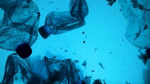 Underwater Footage of Plastic Pollution Problem Concept in Ocean