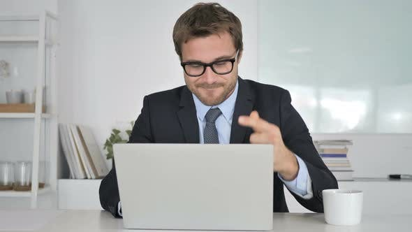 Thumbnail for Pensive Businessman Thinking and Working on Laptop
