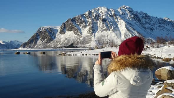 Thumbnail for Girl Taking A Photo Of Sunny Winter Fjord 2