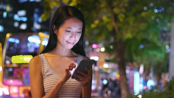 Cover Image for Woman use of smart phone in city