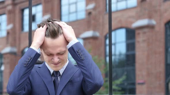 Thumbnail for Upset Young Businessman with Headache and Frustration of Failure