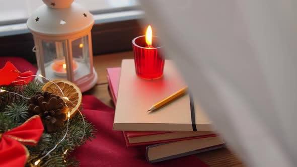 Thumbnail for Christmas Wreath, Books, Candle, Lantern on Window