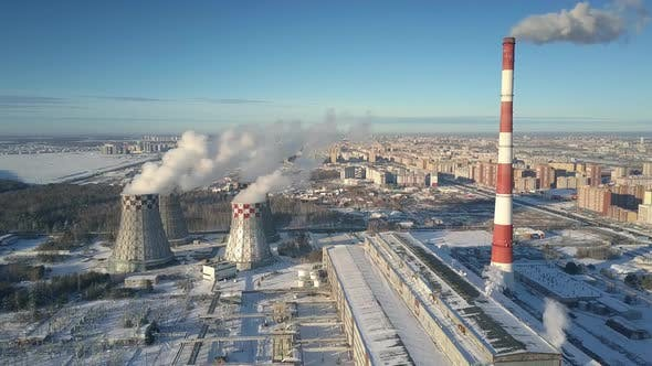 Aerial Motion Cooling Towers Against City and Frozen Lake