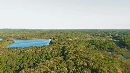 Aerial panorama view on the turquoise color lake between green forest.
