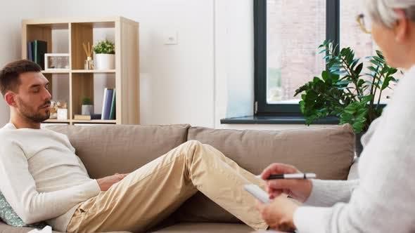 Thumbnail for Man Patient Talking To Senior Woman Psychologist