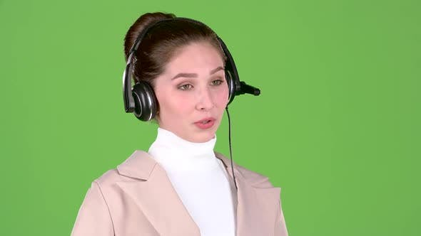 Thumbnail for Manager in the Call Center Talks To the Customers on the Headset. Green Screen