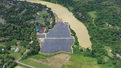 Aerial view of solar panels along Karnaphuli river, Bangladesh.
