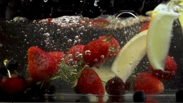 Thumbnail for Bunch of different fruits fall in tank full of water and creating bubbles