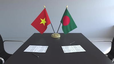 Flags of Vietnam and Bagladesh on the Table