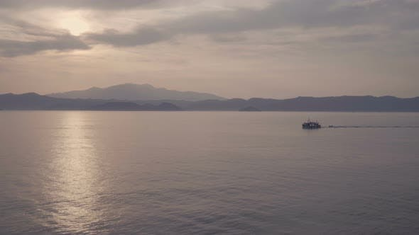 Thumbnail for Scenic Landscape of Cruise Ship Slowly Sailing Through Calm Sea with Cloudy Sky in Limnos, Greece