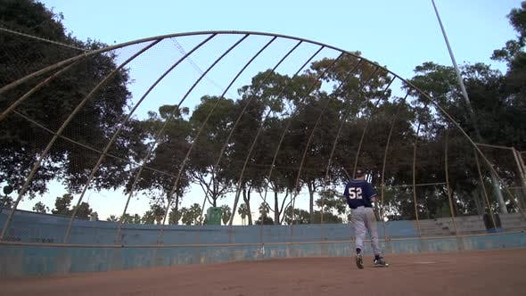 Thumbnail for A baseball player practicing his swing.
