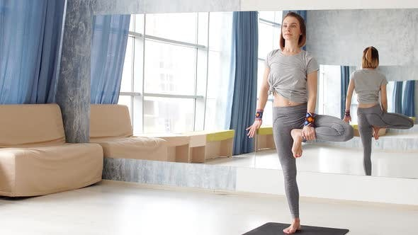 Young Attractive Woman Practicing Yoga