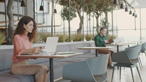 Two People Working in Coworking Space
