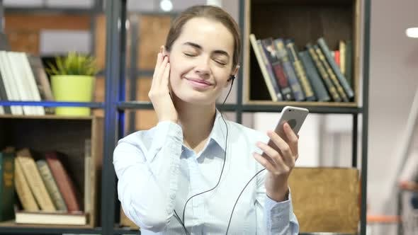 Thumbnail for Female listening Music with headphones, Smartphone