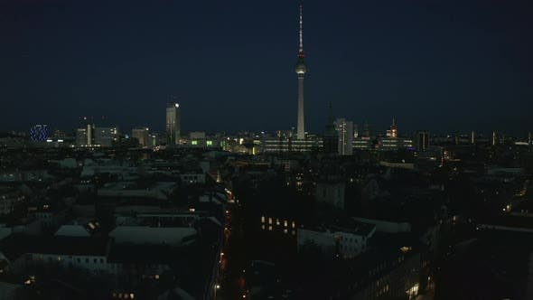 AERIAL View of Empty Berlin Germany Cityscape Skyline at Night with City Light During COVID 19