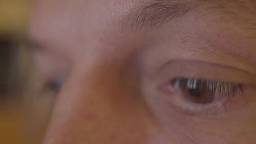 Reflection of the Facebook Logo in the Eyes of a Young Man