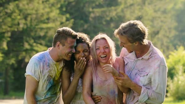 Thumbnail for Laughing Faces of Soaking Wet Excited Friends Celebrating Holi Color Festival