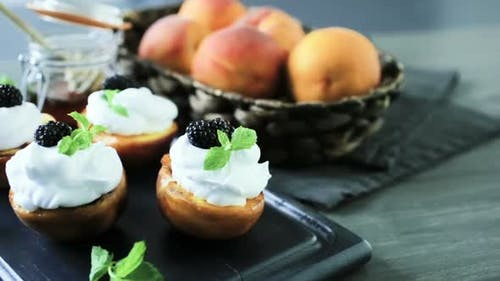 Grilled organic peaches with whipped cream, and garnished with fresh mint.