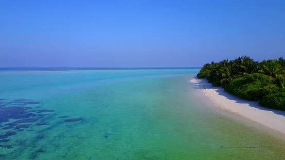 Wide angle drone abstract view of a white paradise beach and blue ocean background in vibrant