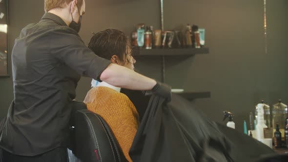 Cover Image for Barber Putting on a Milcoop on His Client in Barbershop