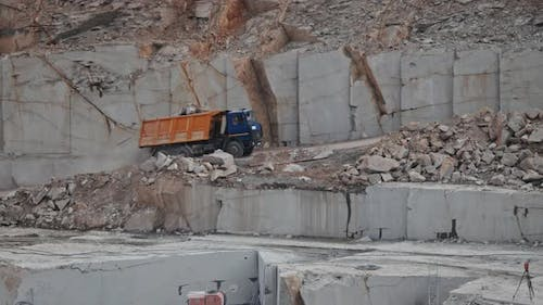 Truck with Rubble Driving in Quarry