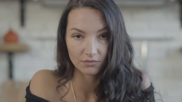 Thumbnail for Headshot of Confident Caucasian Young Woman Looking at Camera