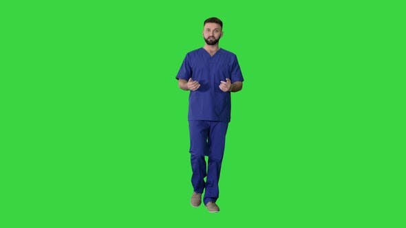 Thumbnail for Male Doctor Surgeon Talking While Walking on a Green Screen, Chroma Key.