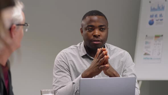 Thumbnail for Afro-American Team Leader Talking to Colleagues at Business Meeting