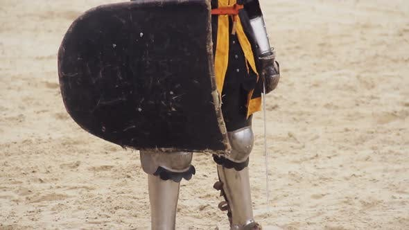 Thumbnail for Brave Man Wearing Steel Armor Standing on Battle Field With Sword and Shield