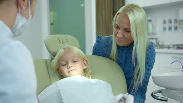 Thumbnail for Dentist Shows To a Girl How a Medical Drill Works