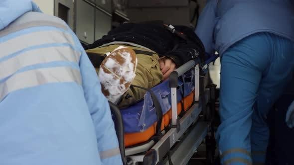 Thumbnail for Paramedics Loading Patient into Ambulance