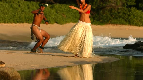 Thumbnail for Polynesian dancers perform at beach in Hawaii, slow motion