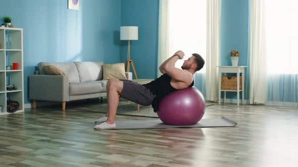 Man Is Doing Upper Crunches on Stability Ball