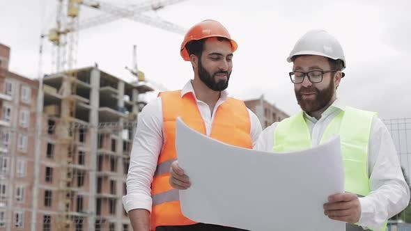 Thumbnail for Smiling Male Construction Engineer Discussion with Architect at Construction Site or Building Site