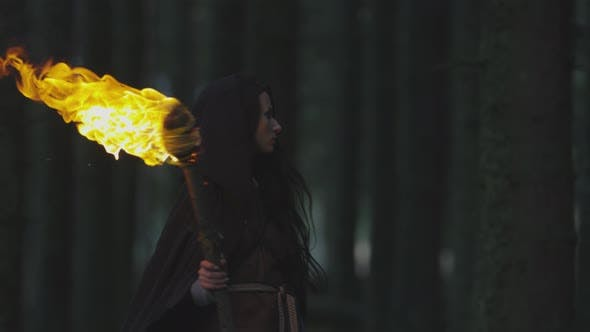 Young woman with a fire staff