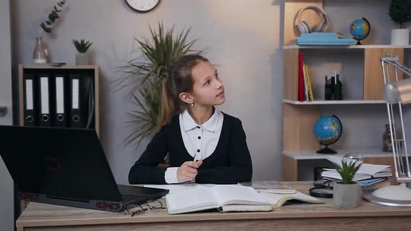 Thumbnail for Dreamy Pretty Teen Girl in School Uniform Writing a Work at Home