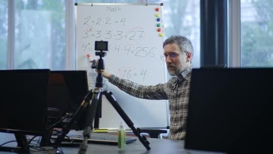 Thumbnail for Teacher Explaining Math To Camera