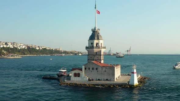 Circling Maiden's Tower with Turkey Flag in the Bosphorus Ocean River in Istanbul in Beautiful