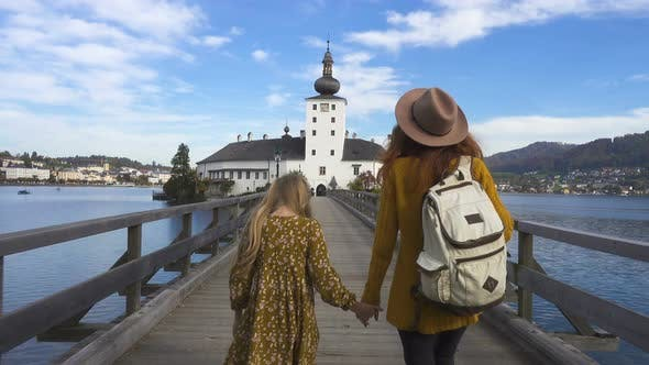 Mother And Daughter  Walking  To The  Castle Schloss Ort