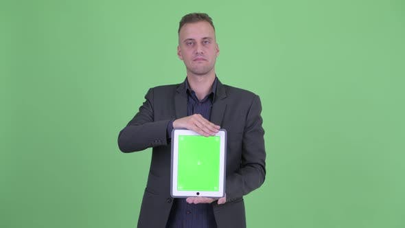 Thumbnail for Stressed Businessman in Suit Showing Digital Tablet