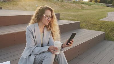 Business Woman Using Smartphone Outdoors