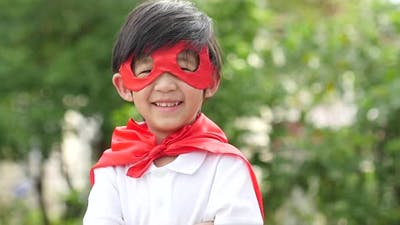 Asian Child In In Superhero Costume Playing In The Park Slow Motion