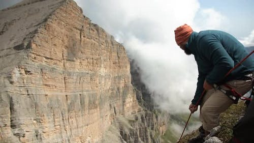 Climber Pulls a Rope in the Mountains. Rescue Operations in the Mountains