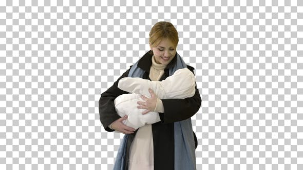 Thumbnail for Young mother with her baby child outdoors at winter, Alpha Channel