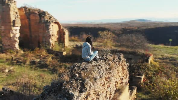 Thumbnail for Female Person Sits On Fortress Ruins